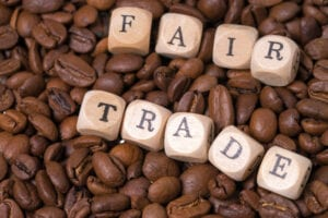 coffee beans with the word fair trade